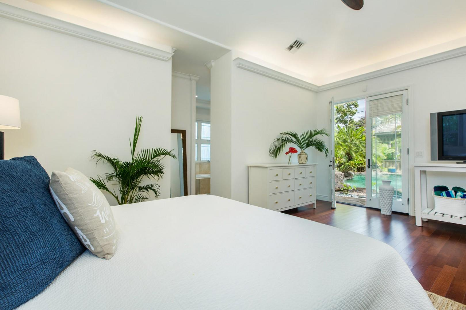 Master bedroom, with view of the pool courtyard.