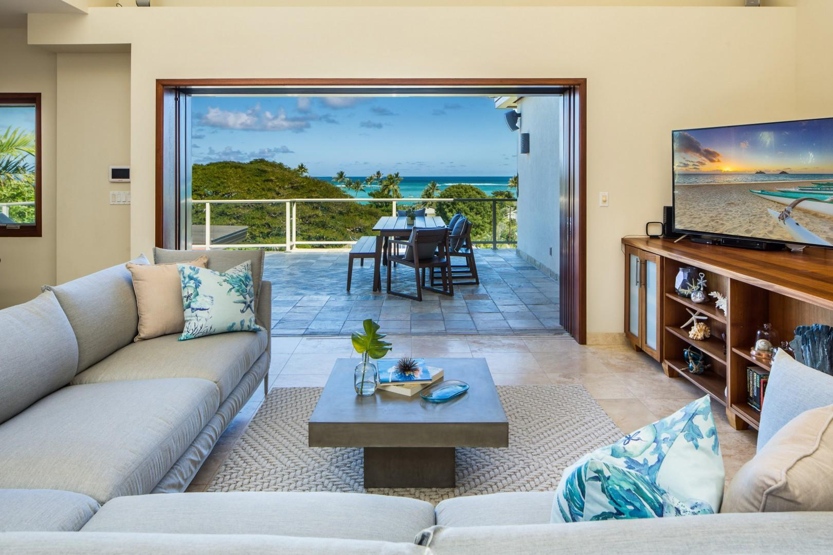 Second floor living room, looking out to the front lanai with sweeping ocean views of the Mokulua Islands.