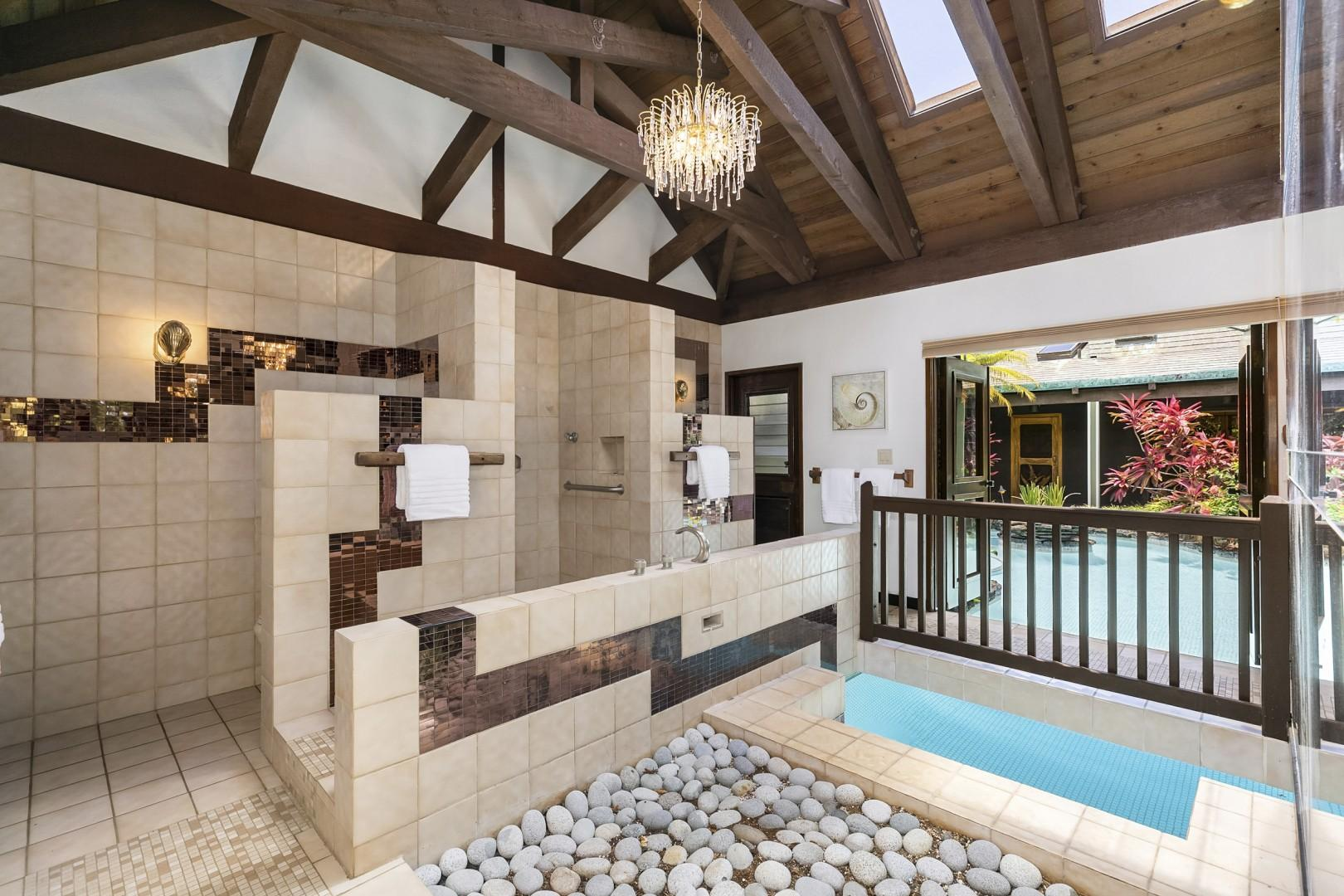 Unique Master Bathroom has his and her toilets and direct entrance to the pool.