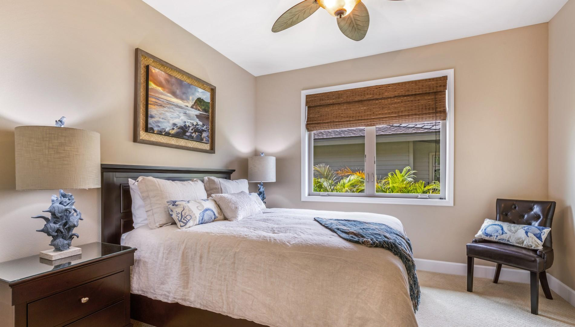 Third bedroom, with queen bed and en suite full bath with tub/shower combo.