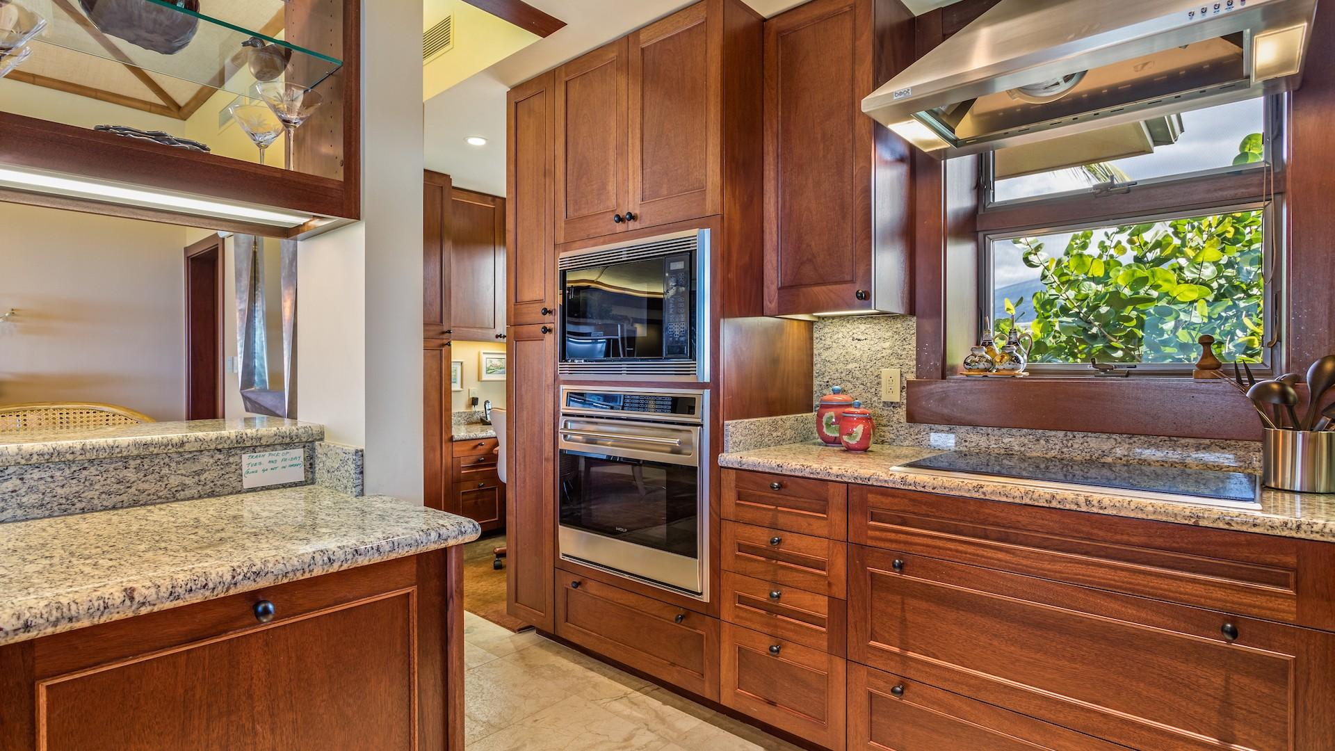 Stainless Steel Appliances & Gleaming Granite Countertops.