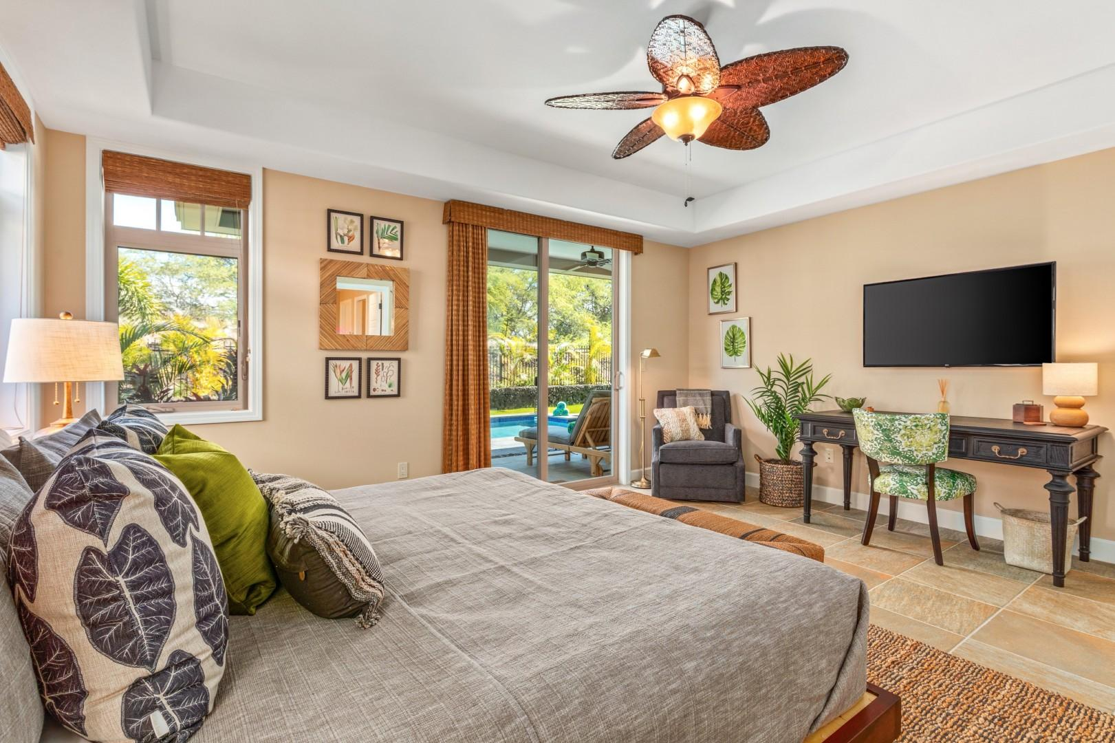 Alternate view of master bedroom highlighting spaciousness, seating area, and natural light.
