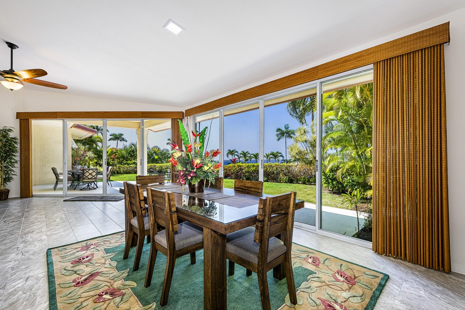 Sliding doors on the ocean side bring nature into the dining room