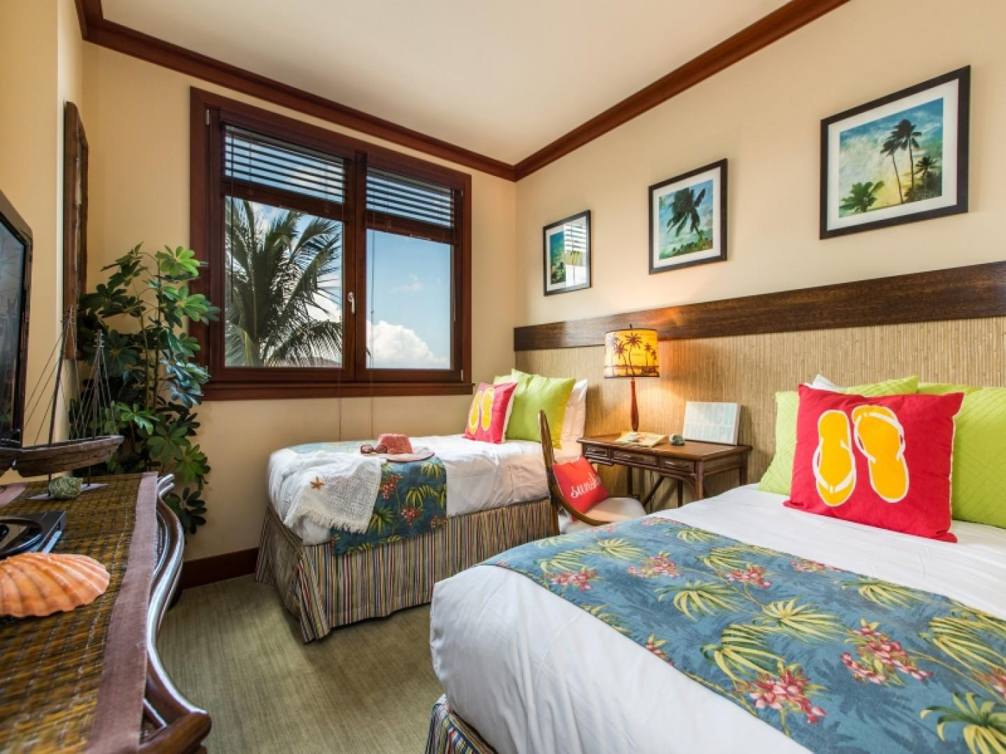 Guest bedroom has two twin beds which can also be converted to a king size bed upon request