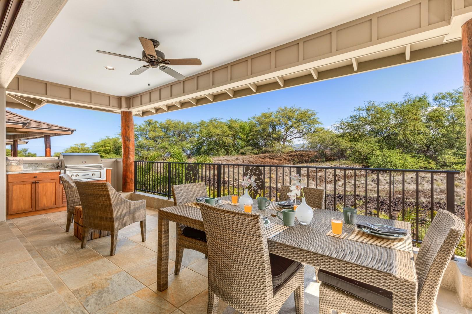 Upstairs terrace with dining area and large Sedona BBQ grill.