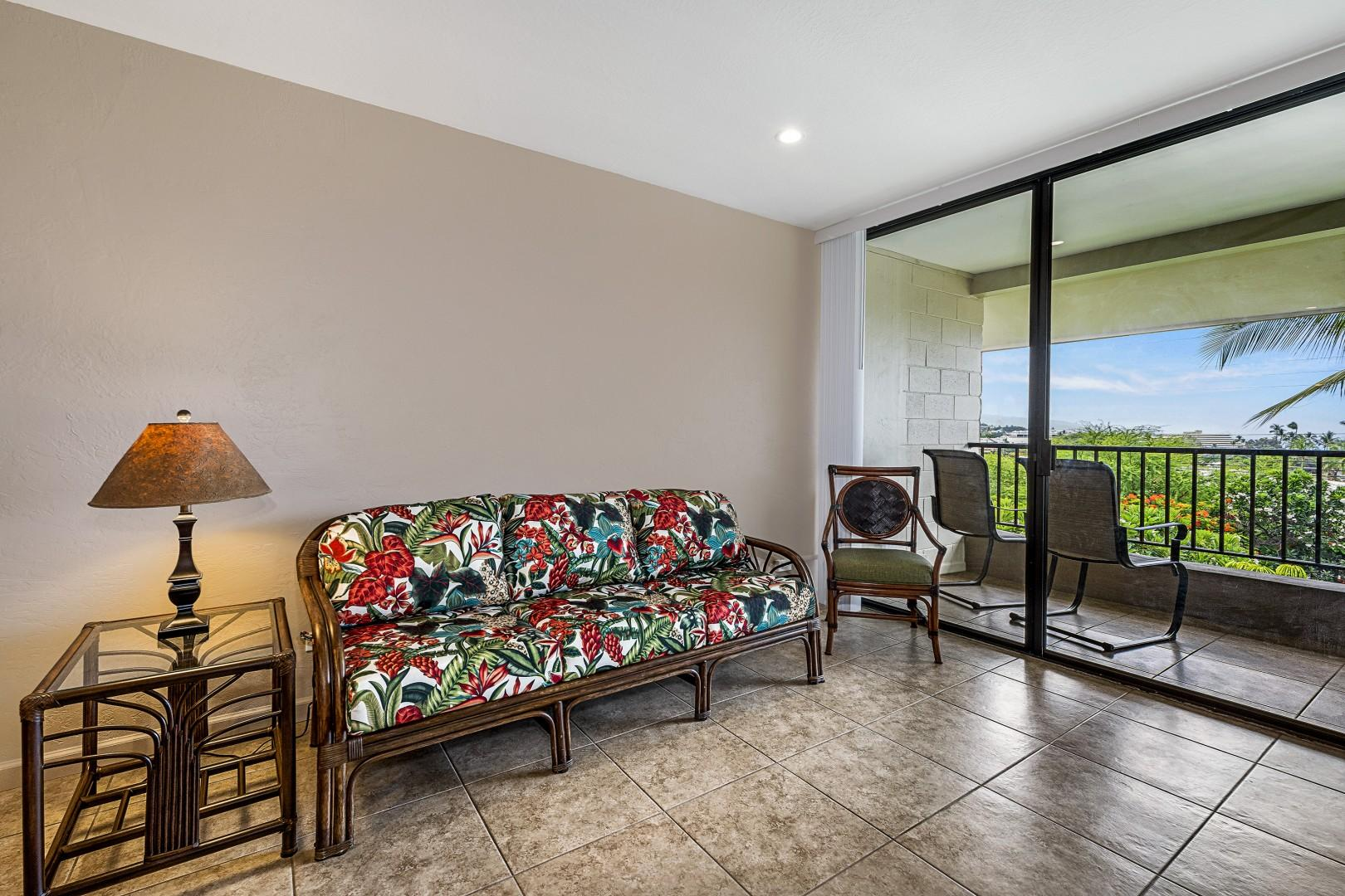 Tropically appointed Living room steps from the Kitchen & Lanai!
