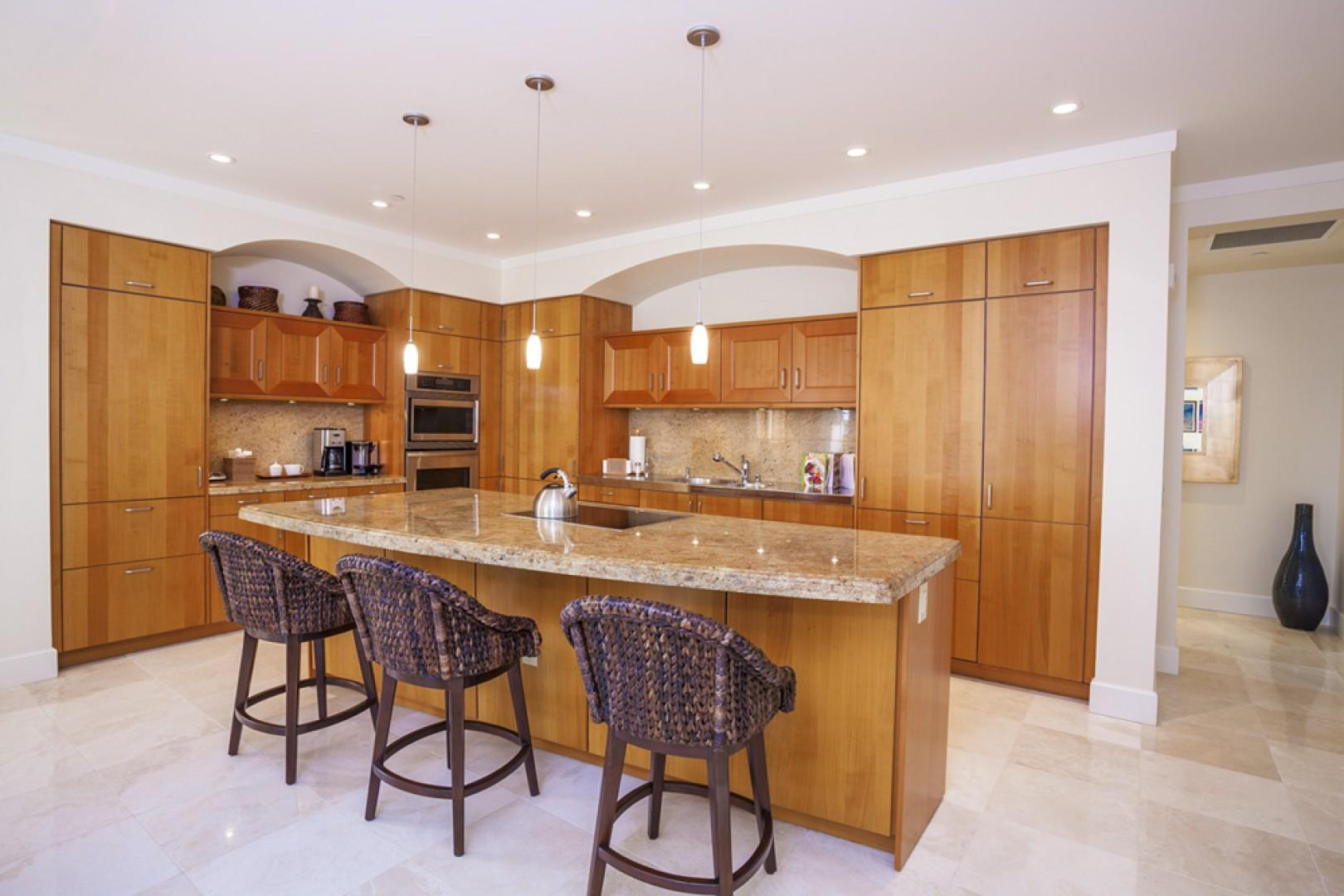 The gleaming kitchen has everything  you need for gourmet meals at home.