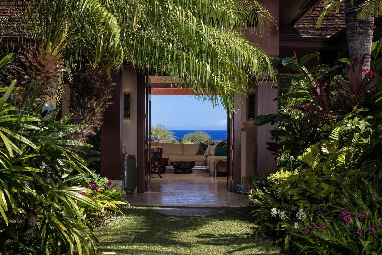 Lushly landscaped courtyard entrance - ocean view before you even walk through the front door!