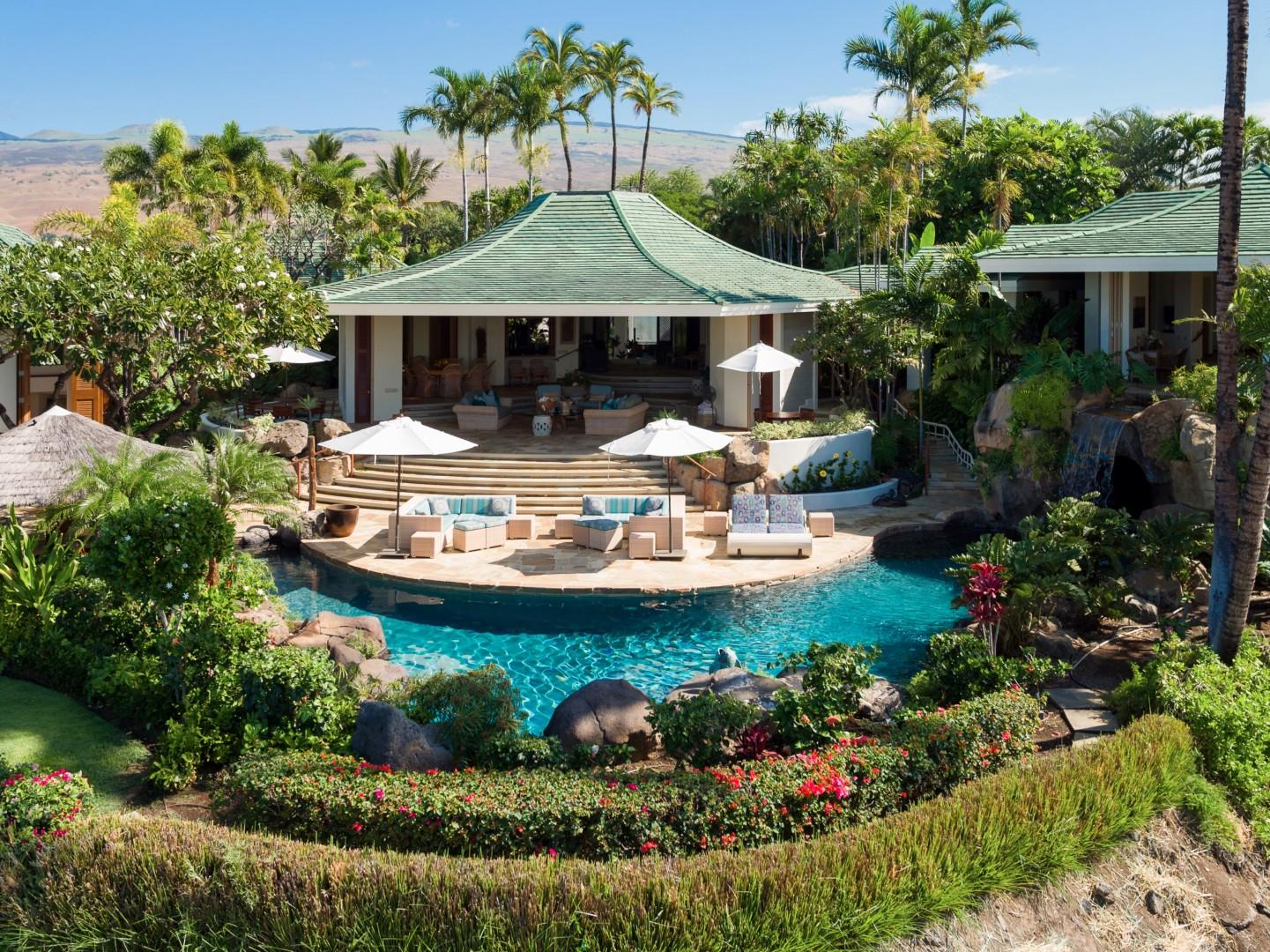 Wide reverse view of pool and generous lanai with view to great room.