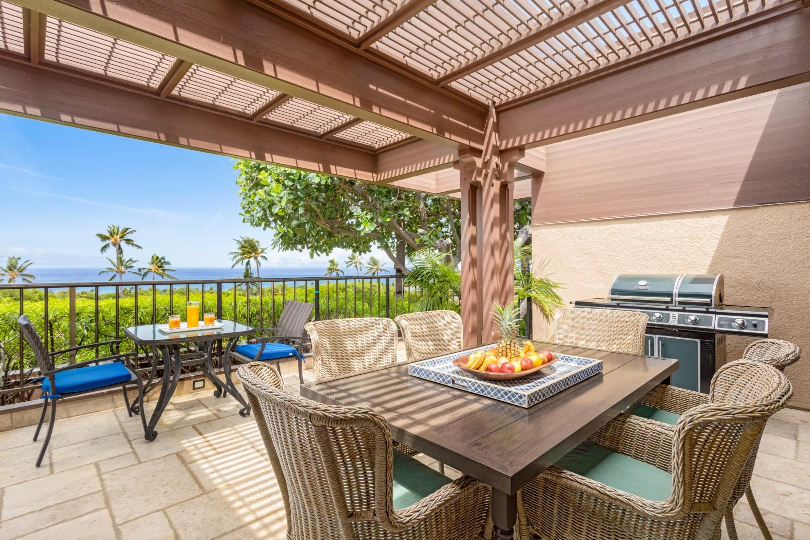 Upper lanai off second bedroom, with outdoor dining seating and barbecue grill.