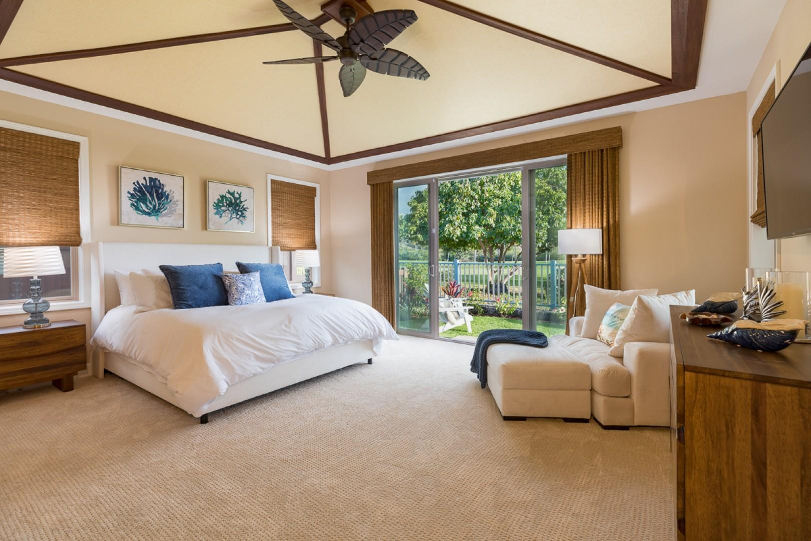 The sizable, welcoming master bedroom