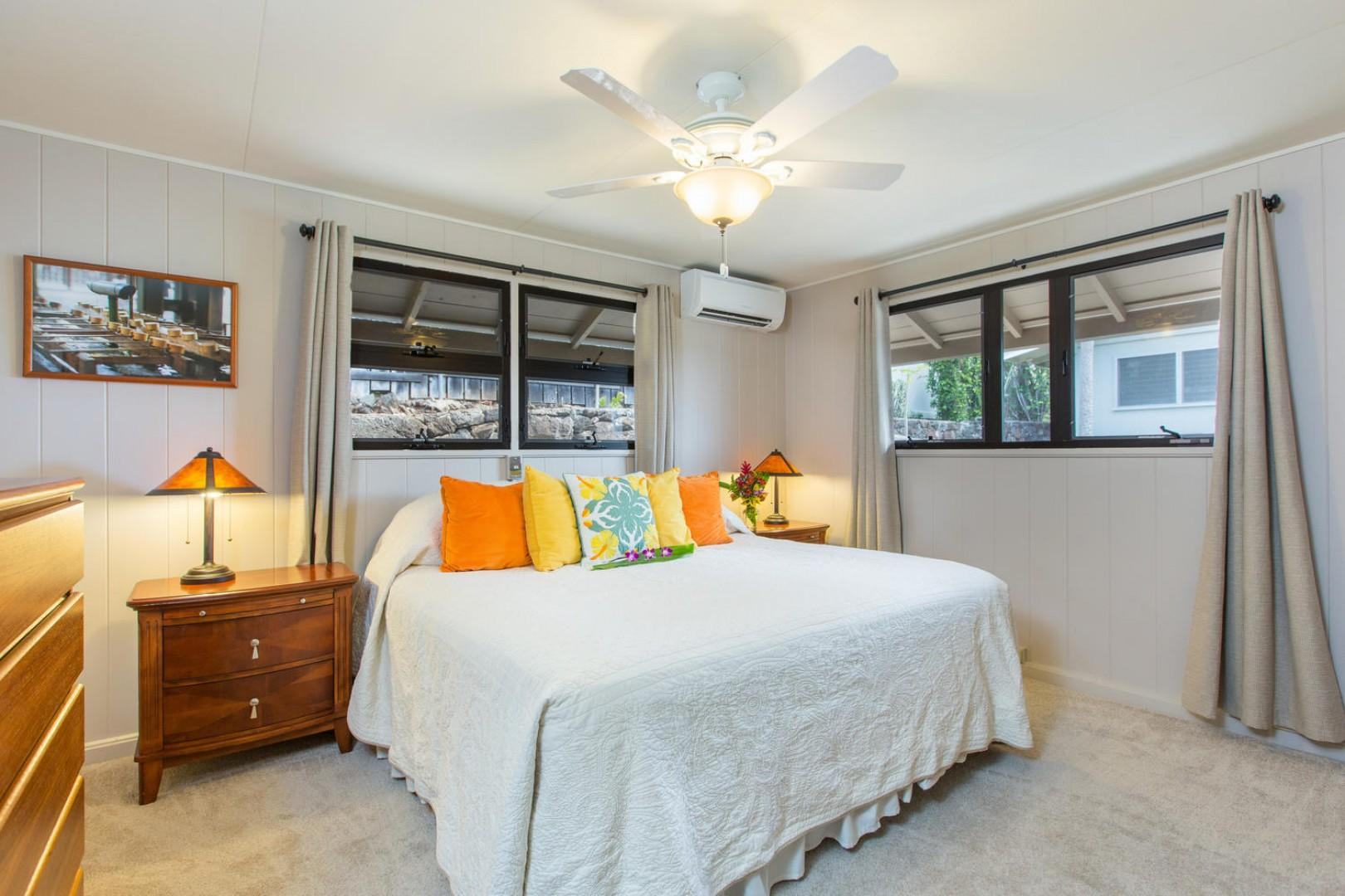 Master bedroom with California king and split air conditioning for warm summer days.