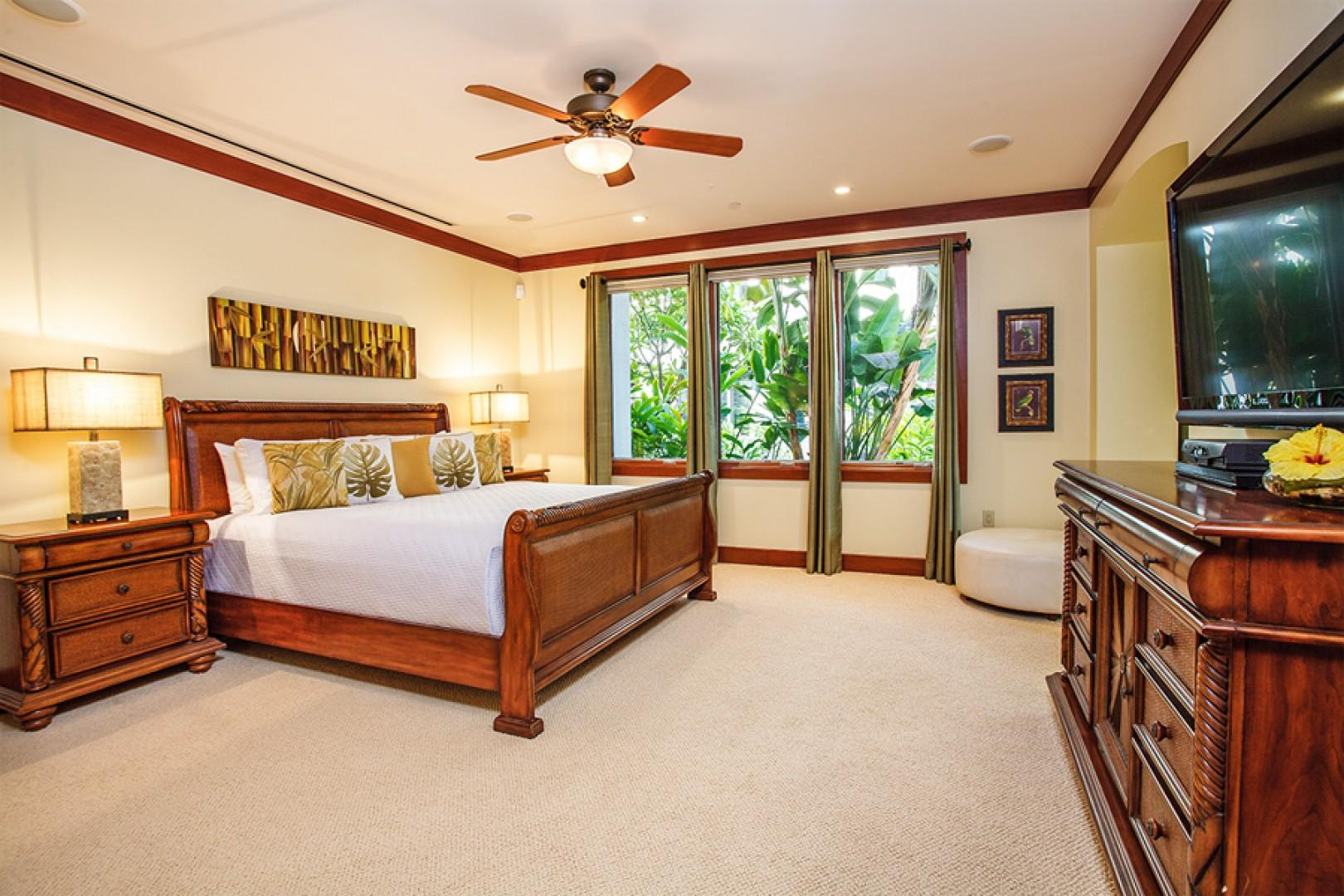 Second master bedroom, with king bed, office nook, and outdoor grotto shower.