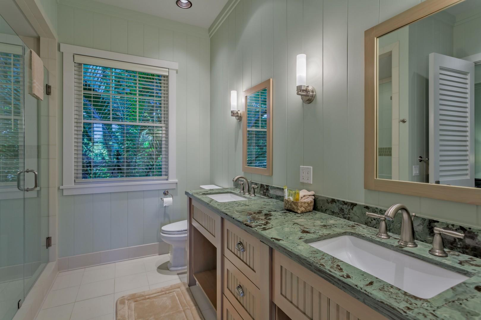 Bathroom 2 w/ Granite Countertops, Double Sink Vanity, Spacious Tiled Shower w/ Two Shower Heads. Two Doors to Bedroom 2 and Hallway.
