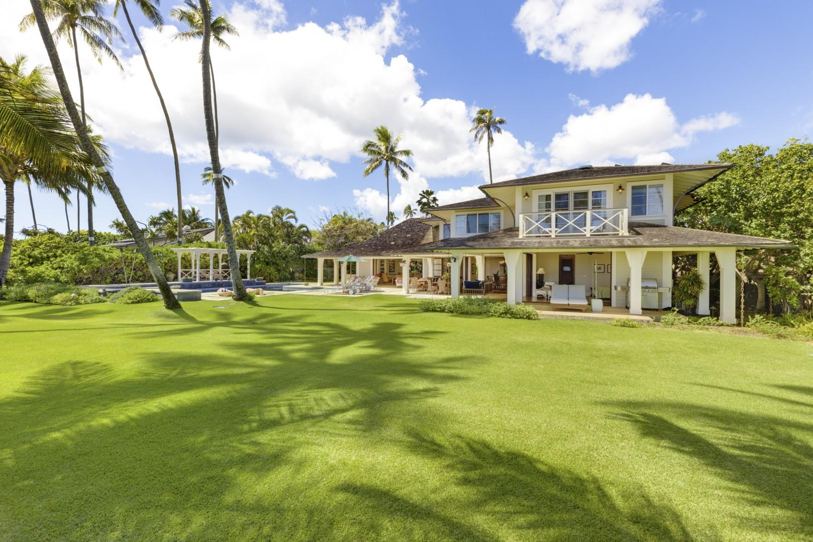 Expansive yard with tropical landscaping