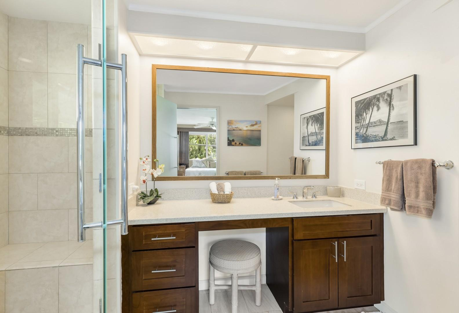 Master bathroom with custom shower and vanity area.