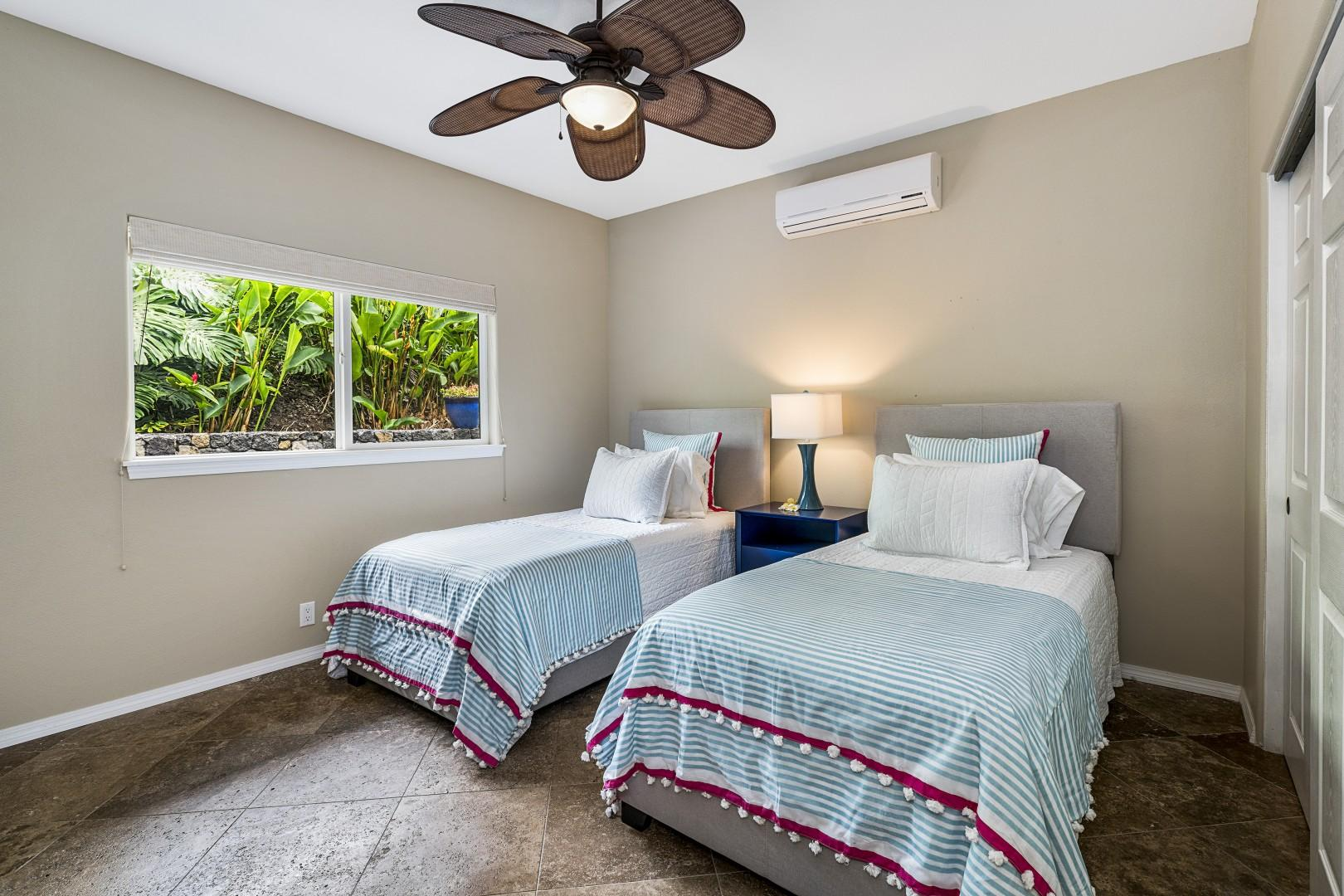 Guest bedroom offering 2 Twin beds & A/C