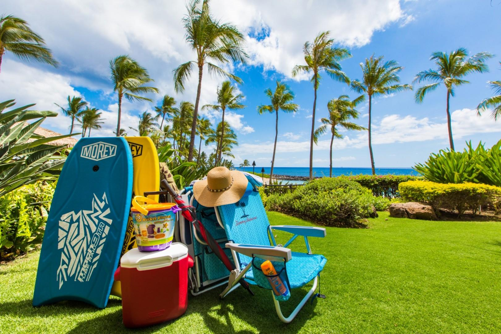 Fully stocked with beach amenities including boogie boards, cooler, beach chairs, beach towels and sand toys