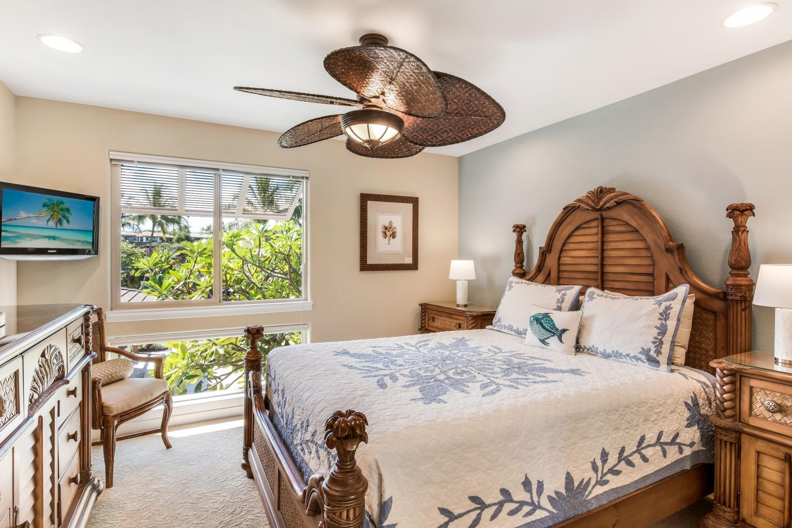Guest Bedroom w/ Queen Bed, TV & Large Window Looking Over Lush Tropical Landscape