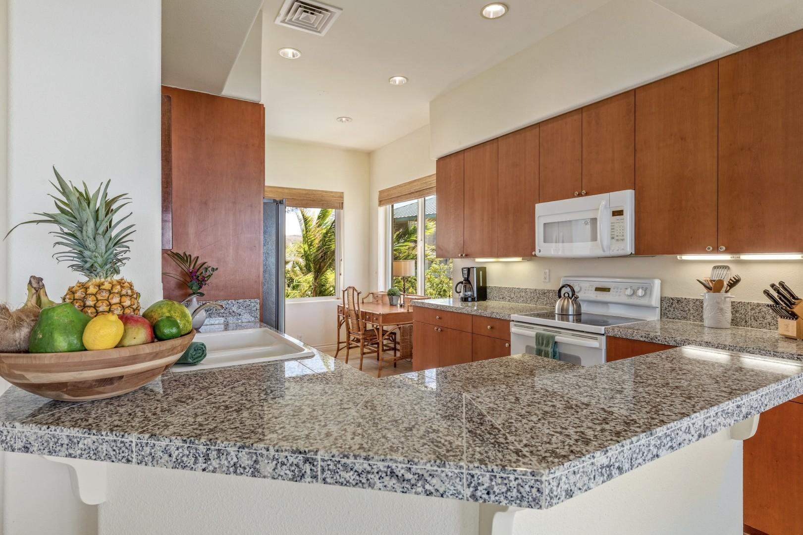 Gleaming granite countertops and modern appliances - a chef's delight!