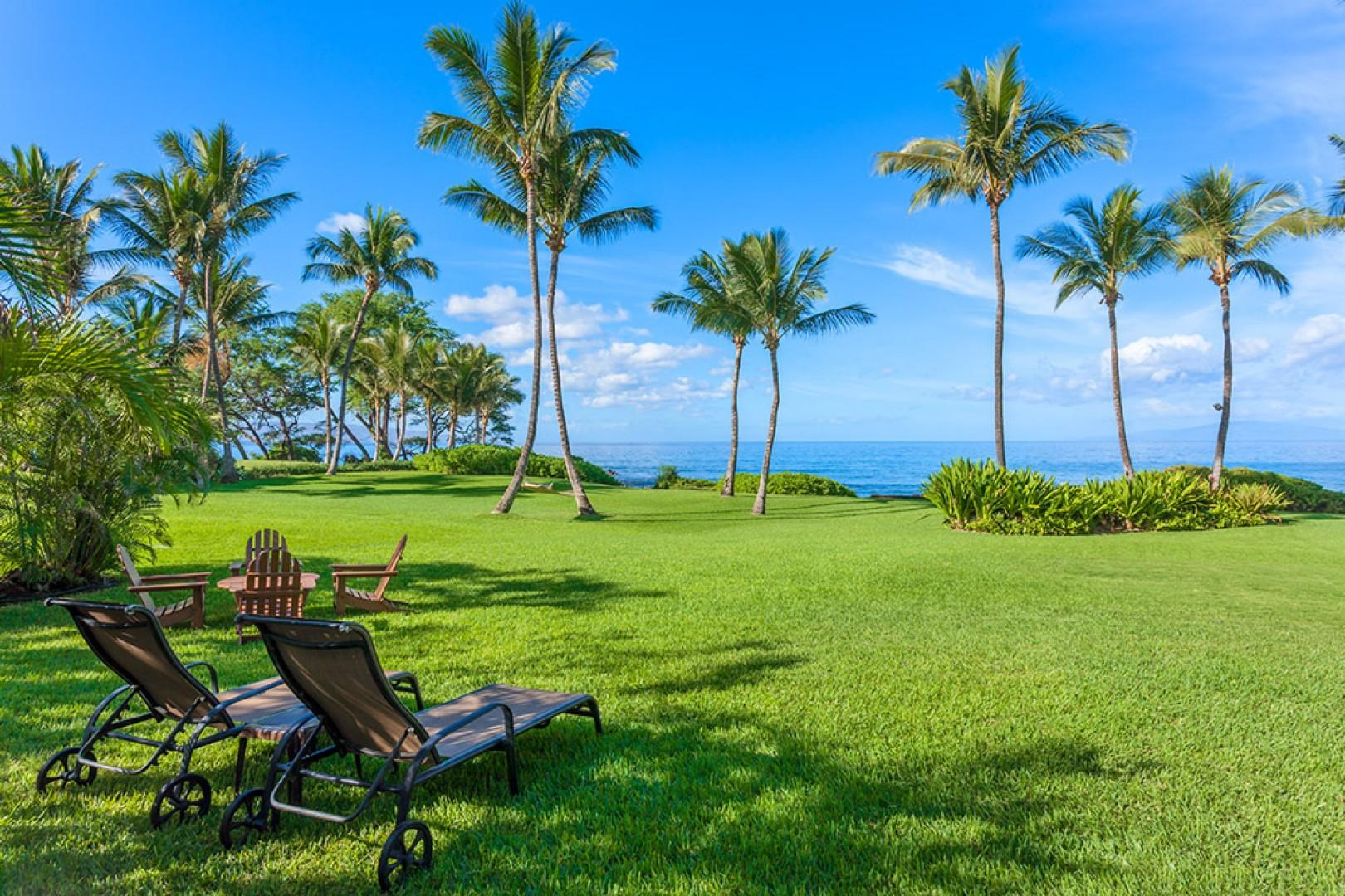 Wailea Sunset Bungalow - Sprawling Grass Yard Meets The Sea at Wailea Sunset Bungalow. A grey sand pebbly beach fronts the property. At the ocean's edge is a campfire pit. Enjoy Stargazing and Roasting Marshmallows at the Sea!