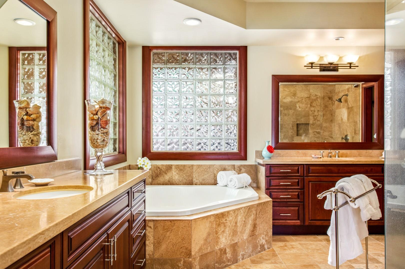 Master bath #2 with dual vanities, large soaking tub and glass enclosed shower.