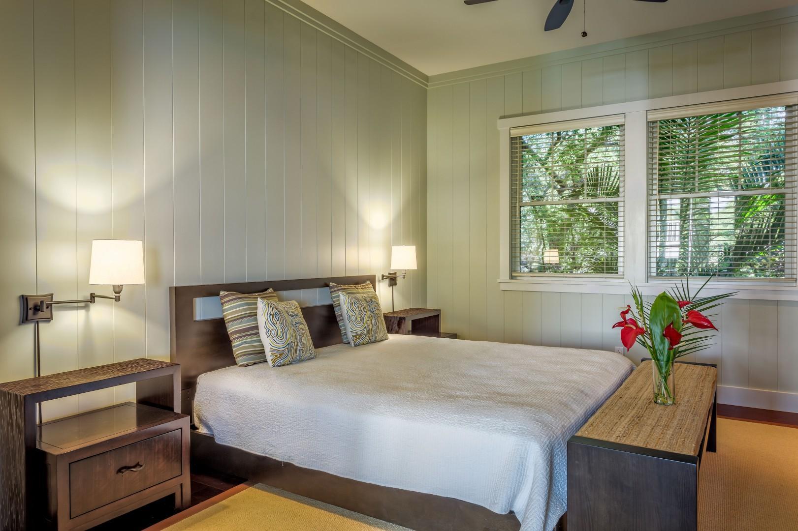 Bedroom 2 w/ King Size Bed, Split Air-Conditioning, Flat Screen Smart TV, Ensuite Bath, Ocean View from Double Pocket Doors to Hallway.