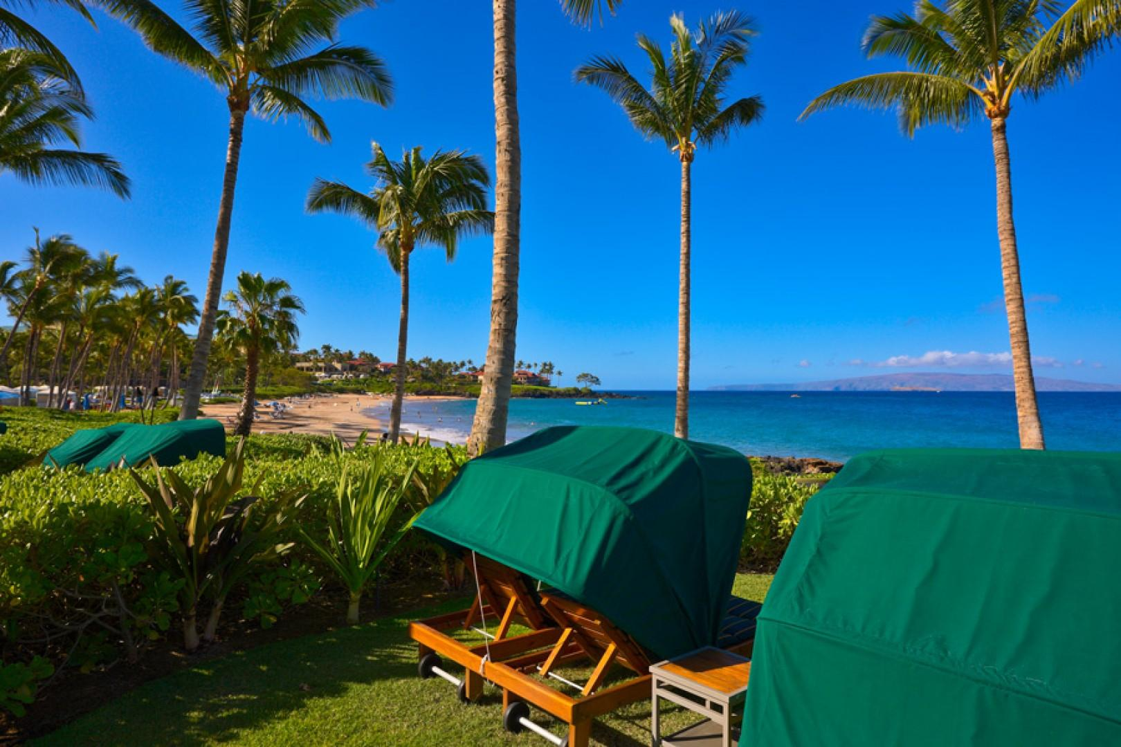 Complimentary oceanfront shaded personal Casabella chaise lounge chairs for guests of Wailea Beach Villas, directly on Wailea Beach.