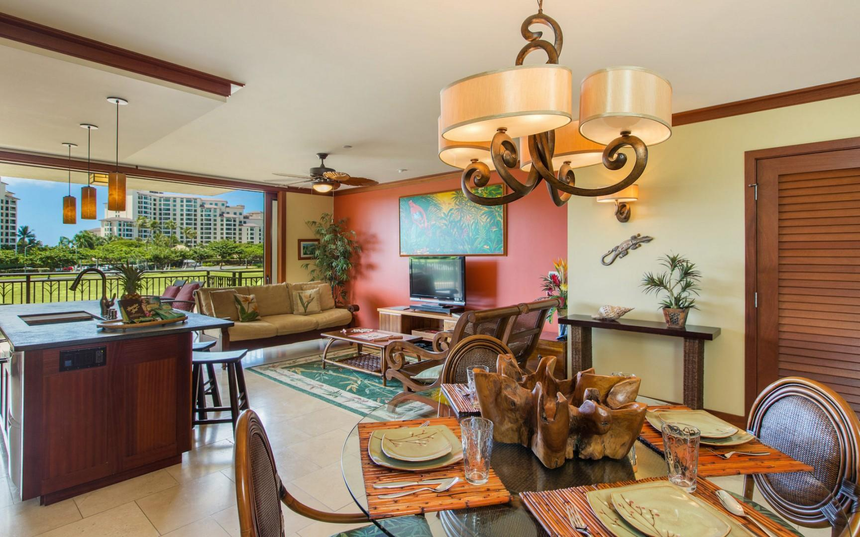 Open kitchen, living and dining area seamlessly connects with the large covered lanai. Pocket lanai doors disappear into the walls beautifully blending indoor and outdoor living.