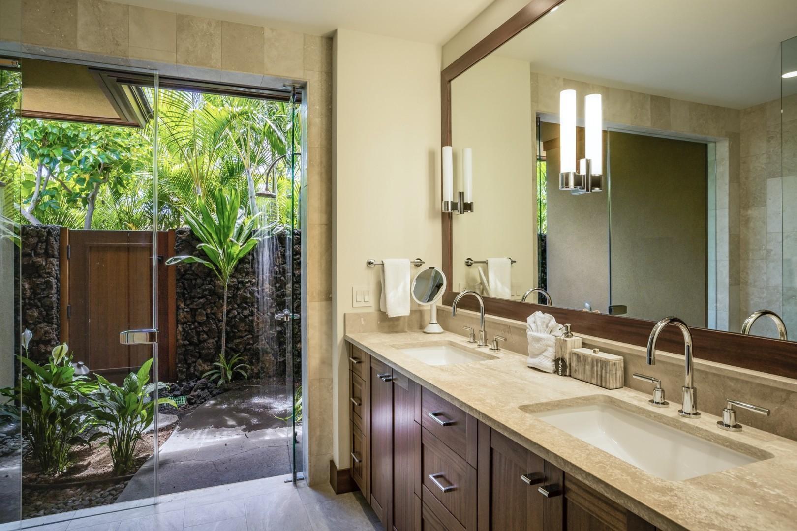 Guest bedroom two en-suite bath with dual vanities, walk-in shower and outdoor shower garden.