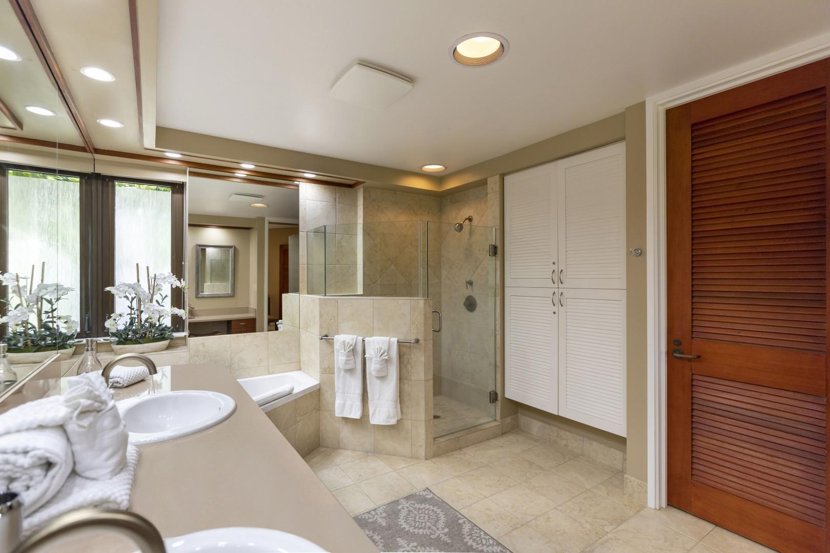 The master bath offers a walk-in shower and double vanities.