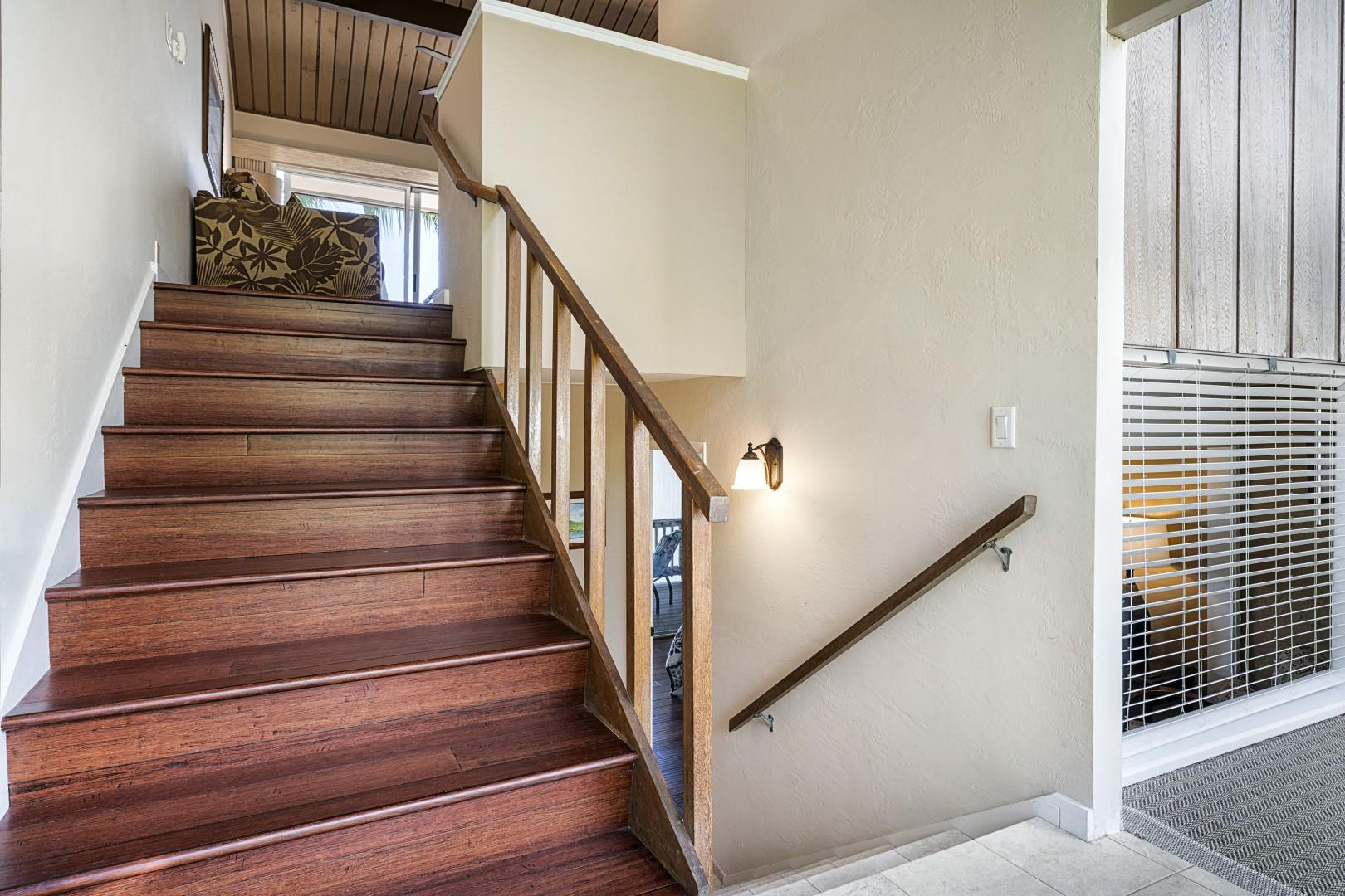 Stairs leading from the entry to the upstairs living and downstairs bedroom