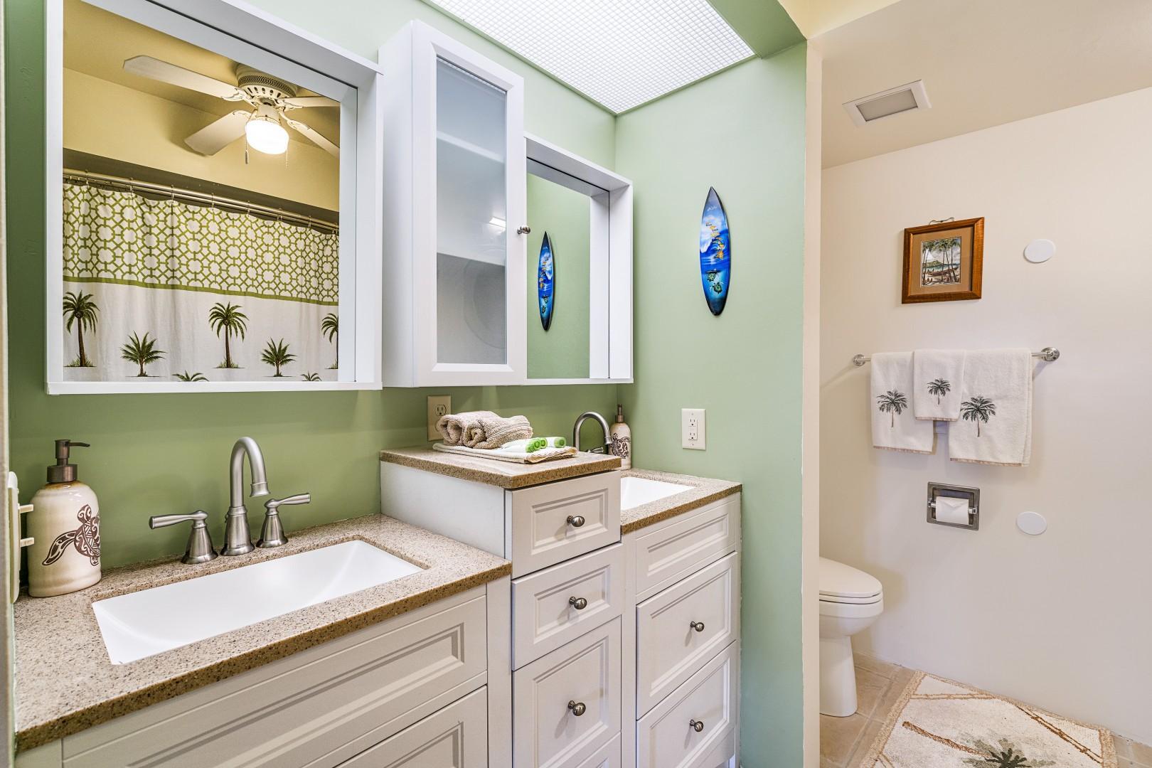 Upgraded bathroom with dual vanities
