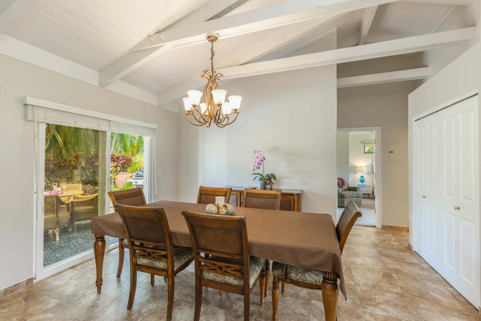 DIning room with seating for six and lanai access
