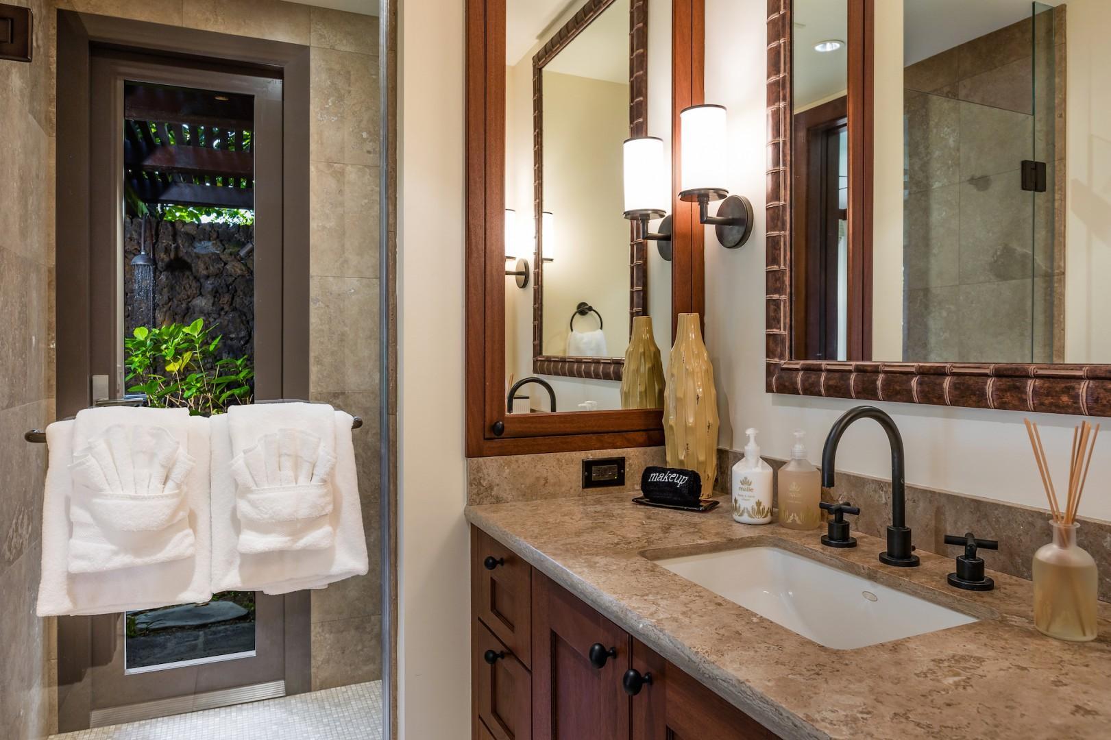 Second bedroom ensuite bathroom with granite counter tops, walk-in indoor shower and outdoor shower garden.
