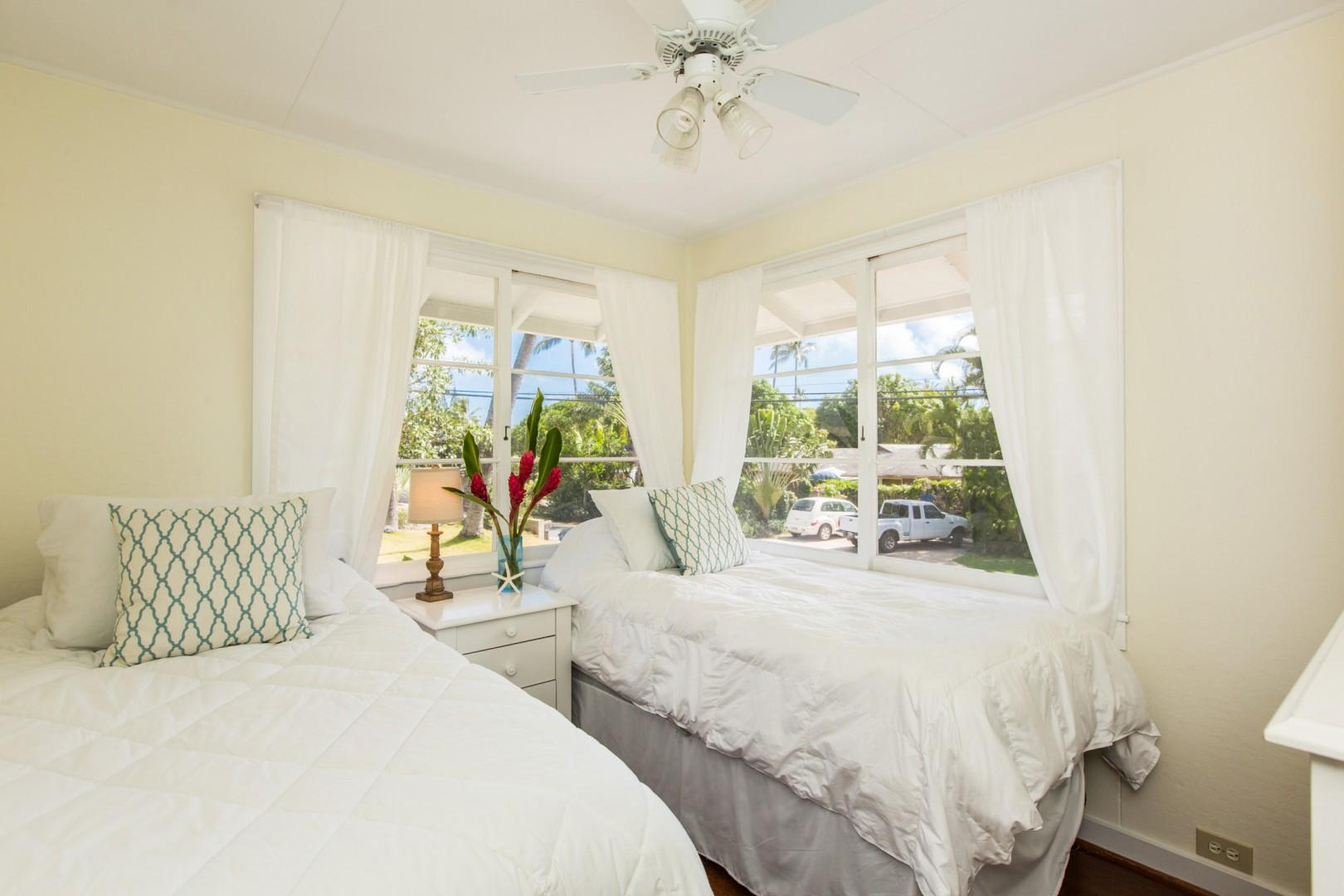 Main house bedroom two, with twin beds (convertible to a king upon request) and new split air conditioning system.