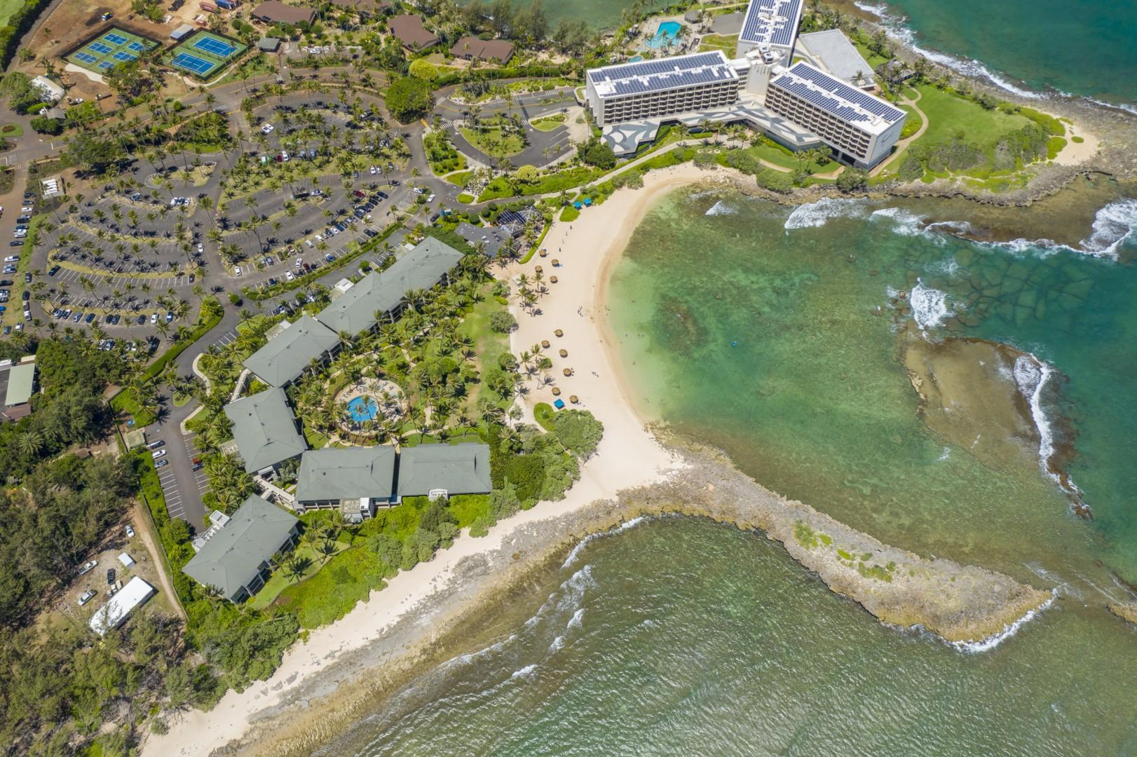Overview of Turtle Bay Resort Hotel, Turtle Bay Ocean Villas and beach lagoon in front.