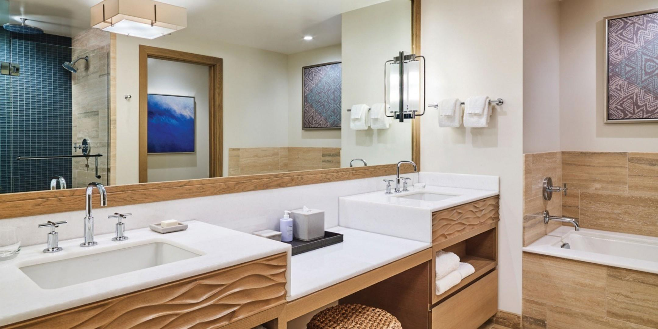 The spa-like bathrooms at Hokuala feature deep tubs, separate showers, and dual vanities.