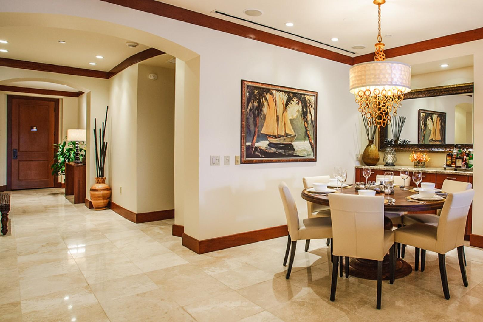 Indoor dining space with 60-inch mango wood table.