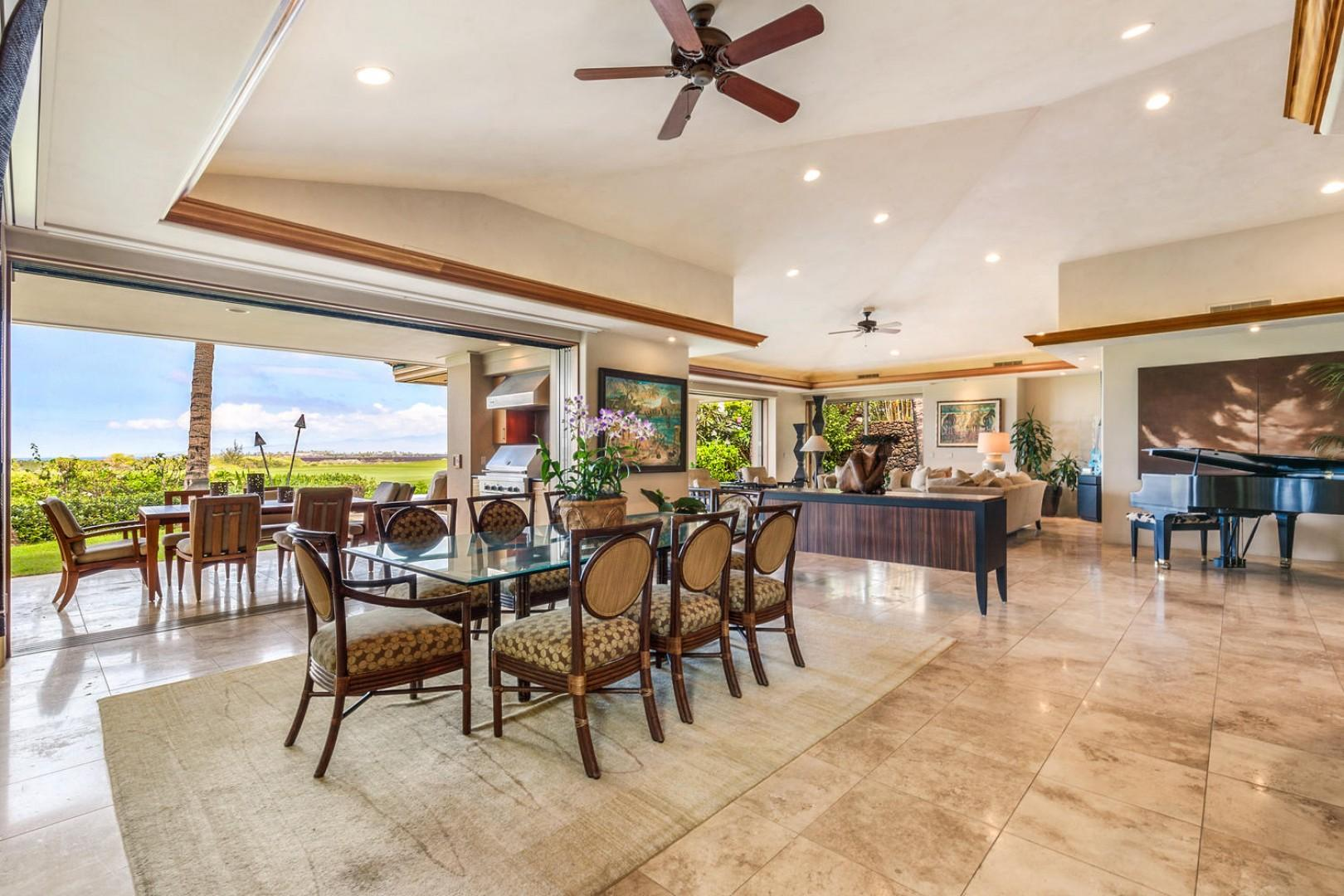 Wide view of great room w/indoor dining, outdoor dining, & living areas.