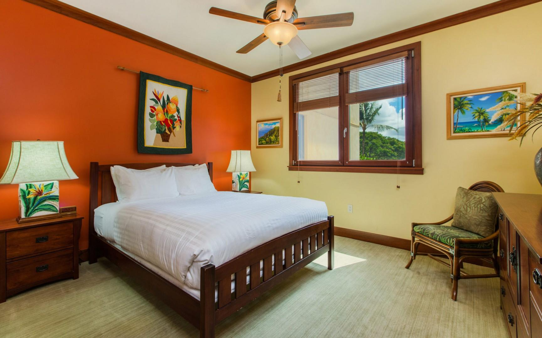 The 2nd (guest) bedroom features a Queen bed, dresser, and ceiling fan