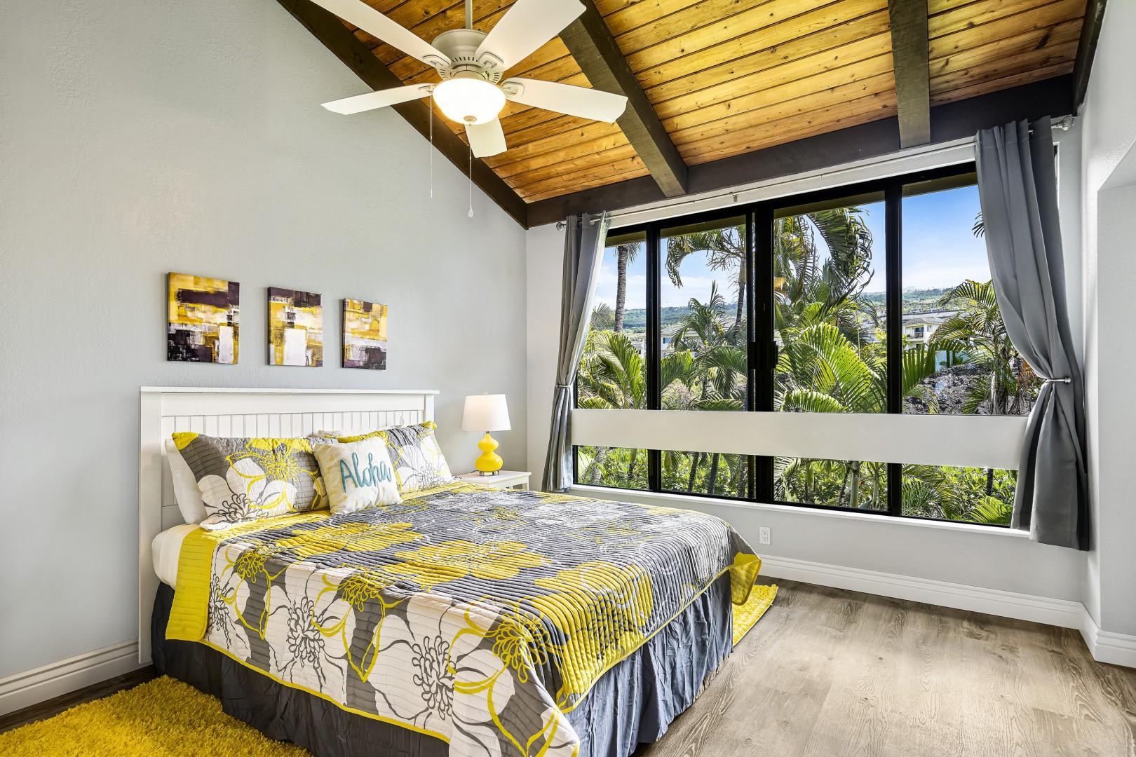Guest bedroom offering A/C, mountain views, Queen bed, vaulted ceilings and a rejuvenating color scheme