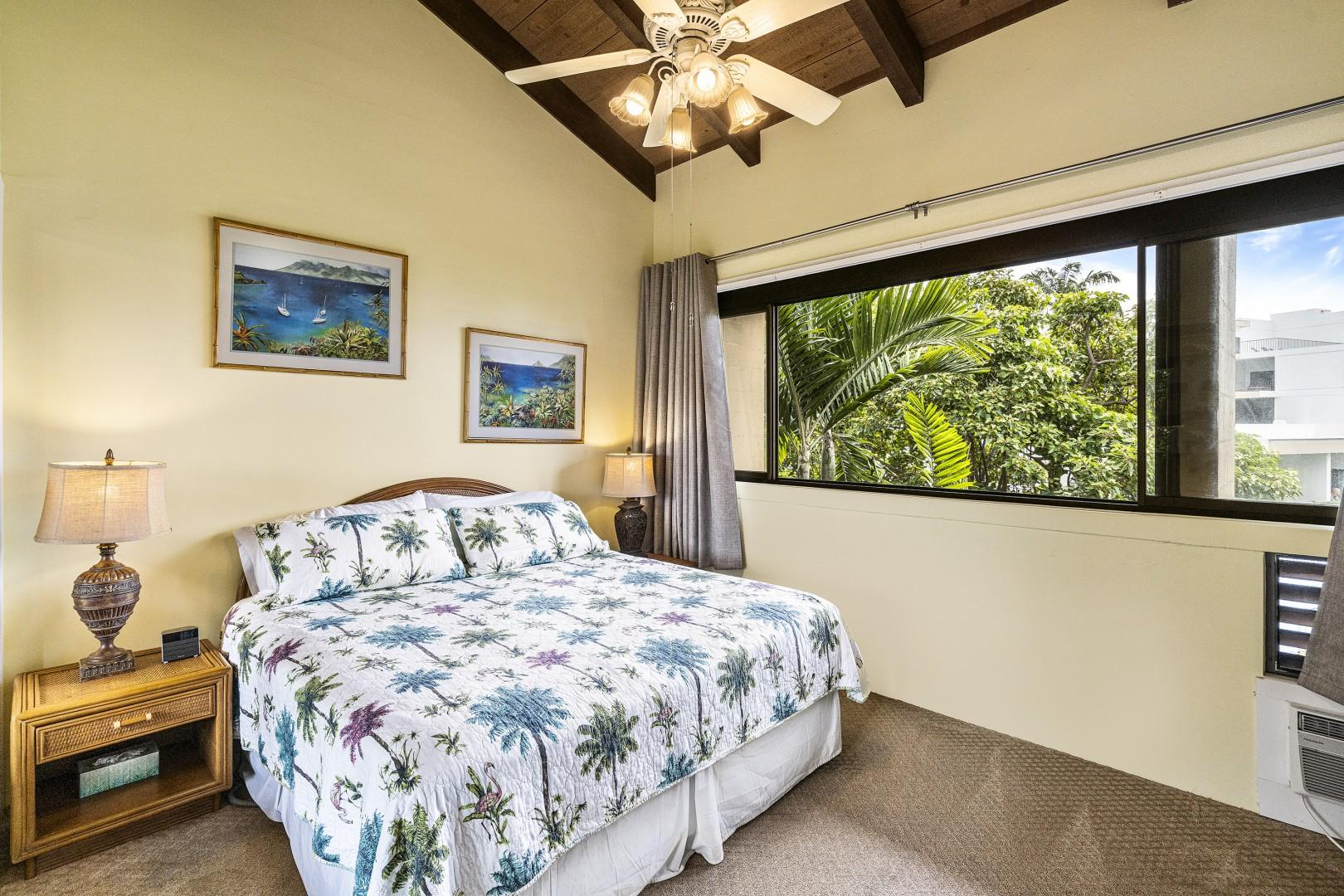 Master bedroom equipped with King bed, A/C, ceiling fan and bathroom steps from the unit