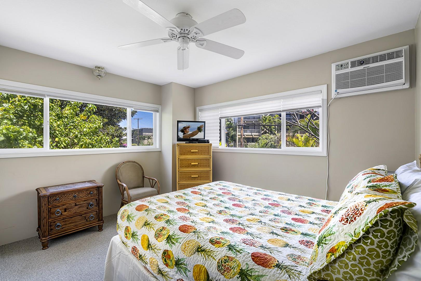 Guest bedroom with TV with view of the foliage!