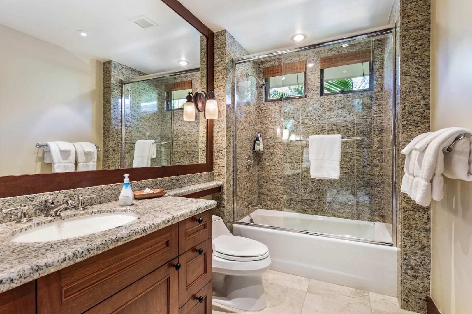 Second full bathroom, en suite, with elegant granite and shower/tub combo.