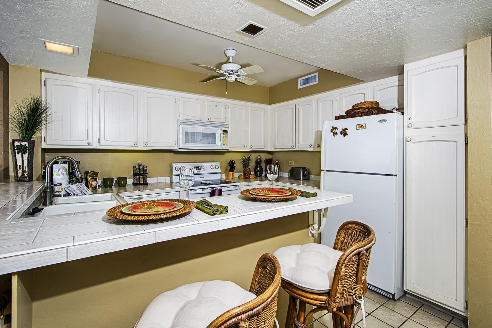 Fully equipped kitchen steps from the outdoor dining