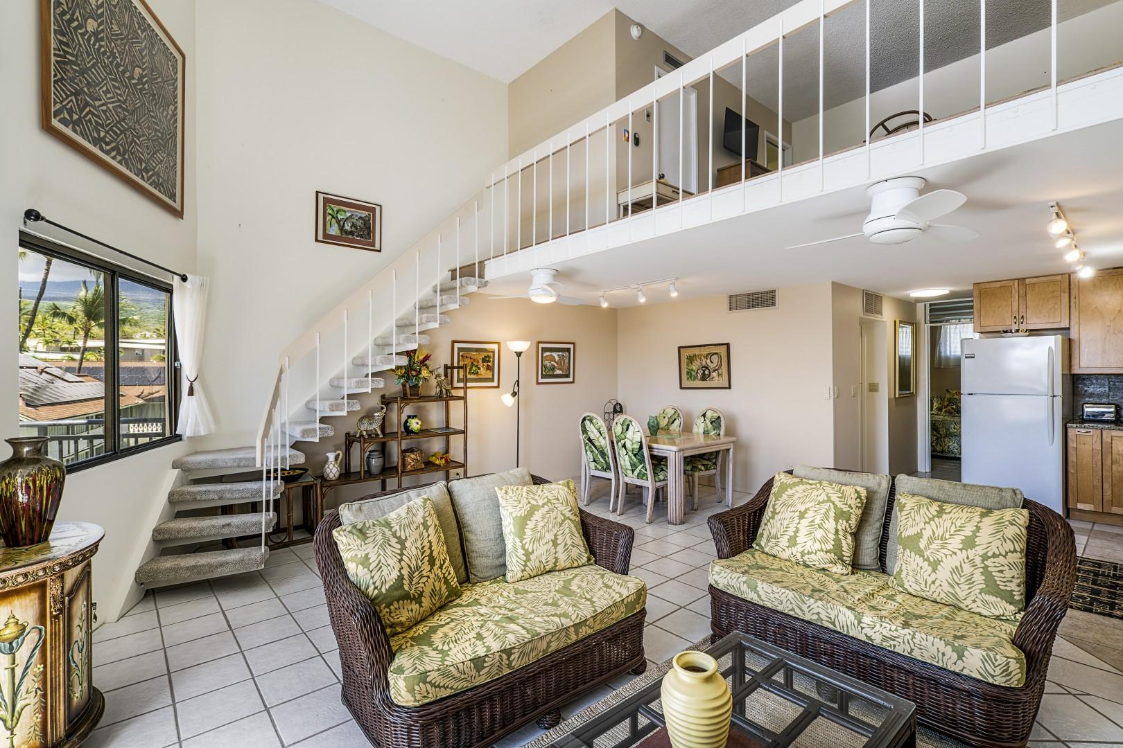 Living room, facing toward the stairs, leading to the upstairs bedroom.