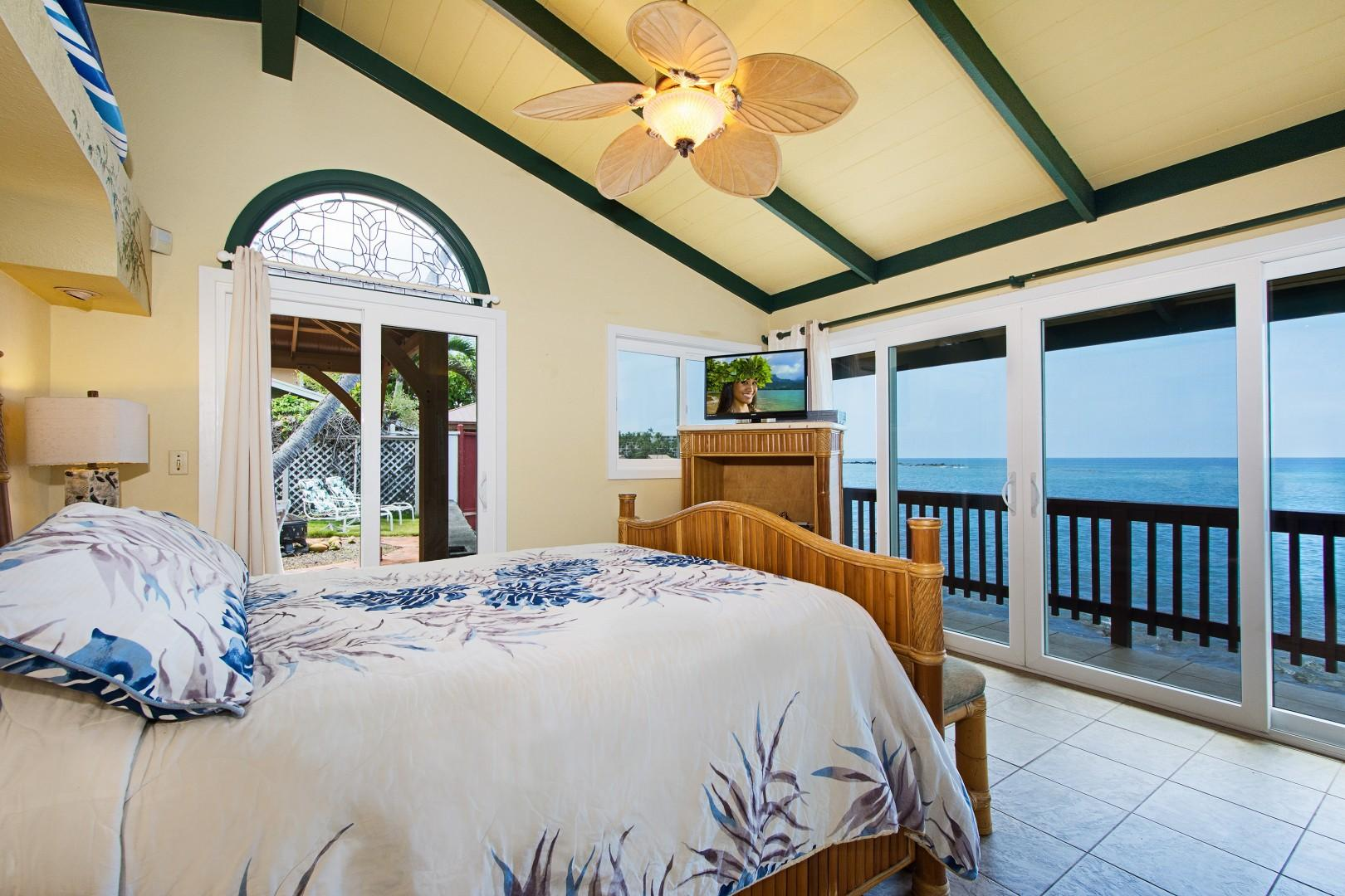 King sized bed in the bedroom with gorgeous Ocean views!
