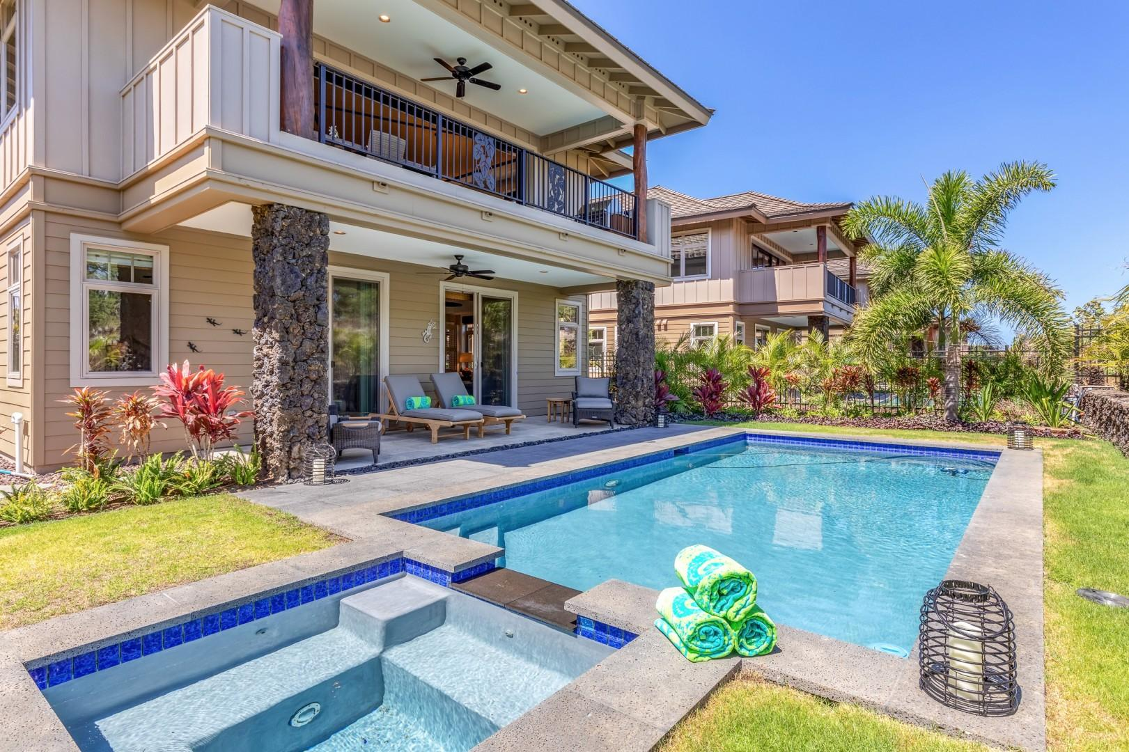 Private pool, jacuzzi and tropically landscaped garden appoint the backyard of this elegant split-level home.