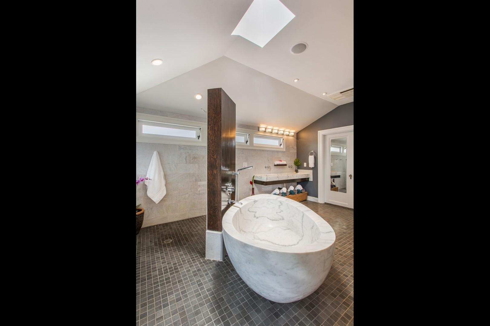 Master en suite, with an amazing marble tub! The perfect spot to soak after a long day of fun in the sun.